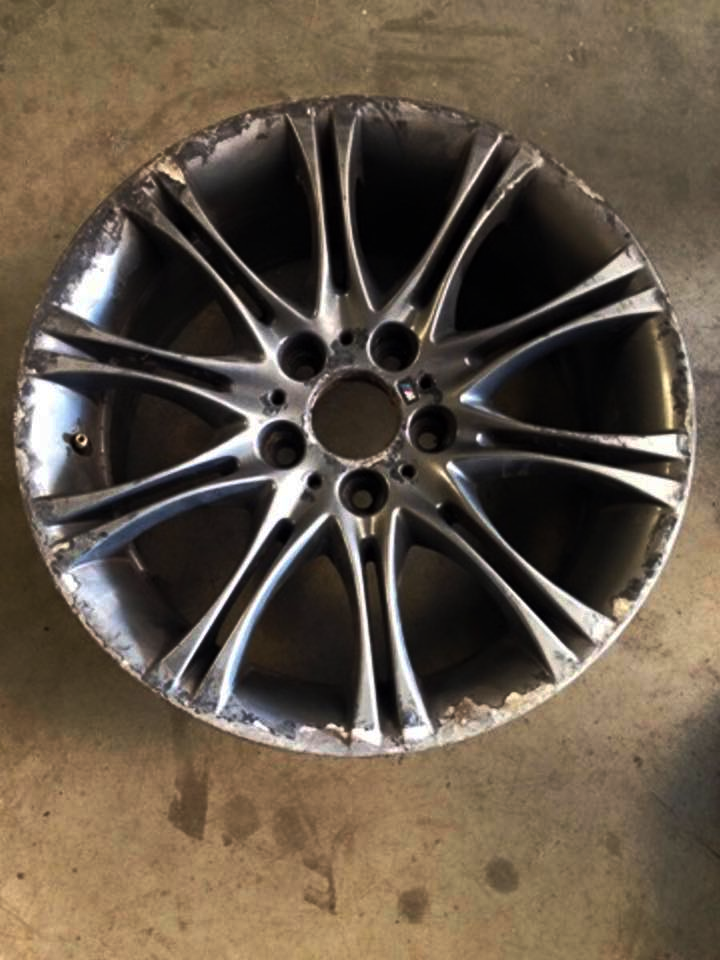 BMW wheels with severe kerb damage
